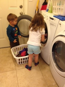 My daughter, with the help of her little brother, loading the washer. Of course, having a front loader is pretty clutch for this type of independence.