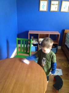 My 3 year old cleaning crayon off of his table.