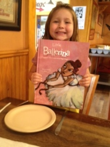 At our fancy pizza lunch with the book she chose. It is a wonderful story based on Edward Degas' ballerina paintings!