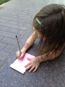 As we waited for the Museum doors to open, she was inspired to draw.