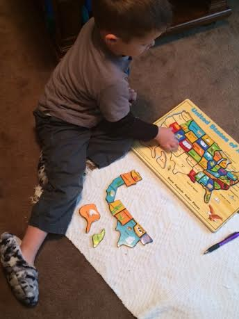 This is my son doing his culture work. He is just trying to recreate the states puzzle.